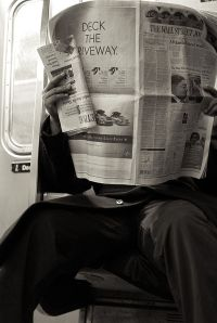 2009_reading_newspaper_NYC_4328271821